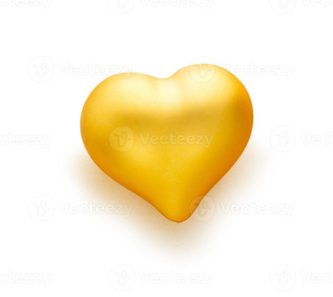 corazon dorado sobre fondo blanco foto