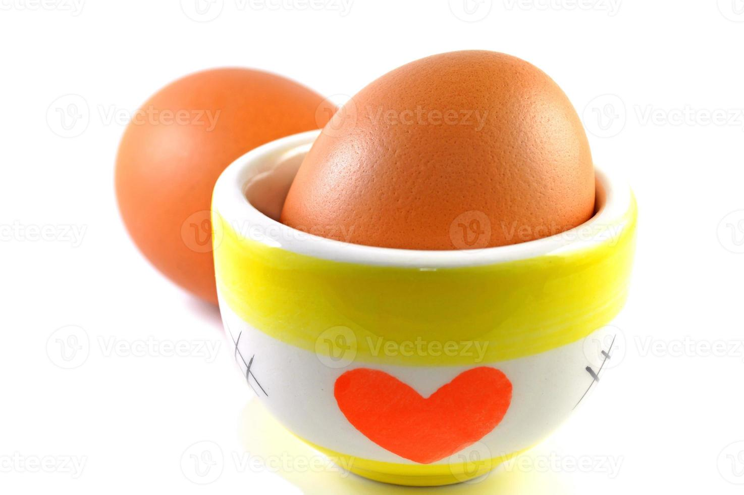 Eggs and ceramic cup photo