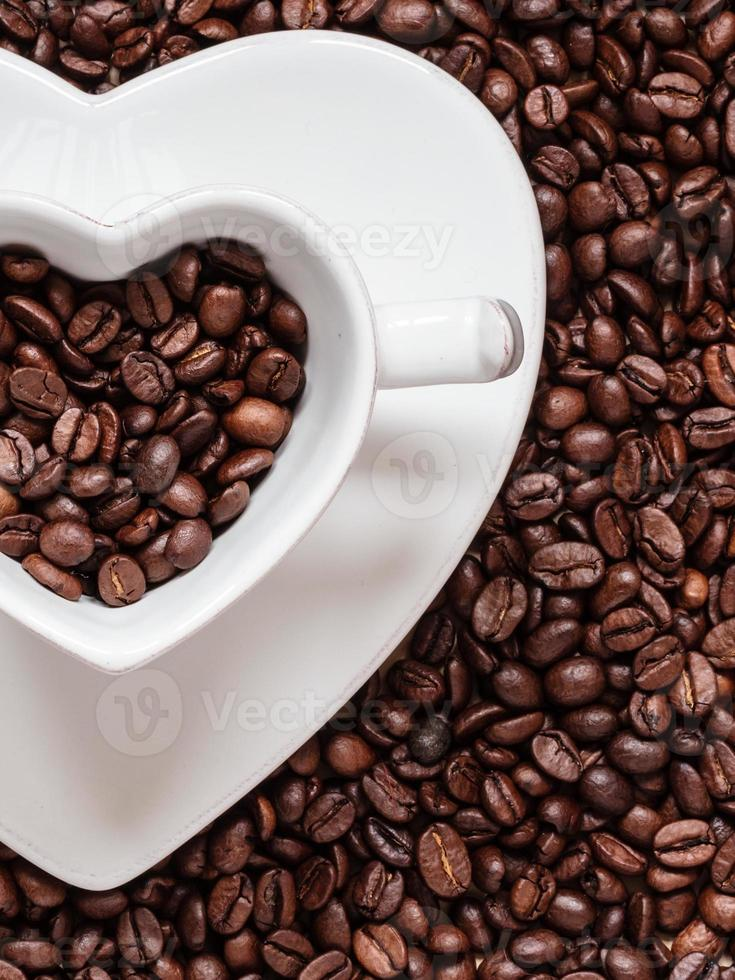 cup and saucer on coffee beans background photo