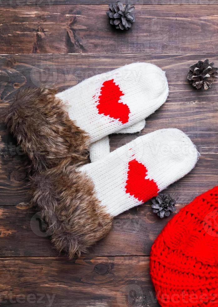 Cute knitted mittens with red hearts photo