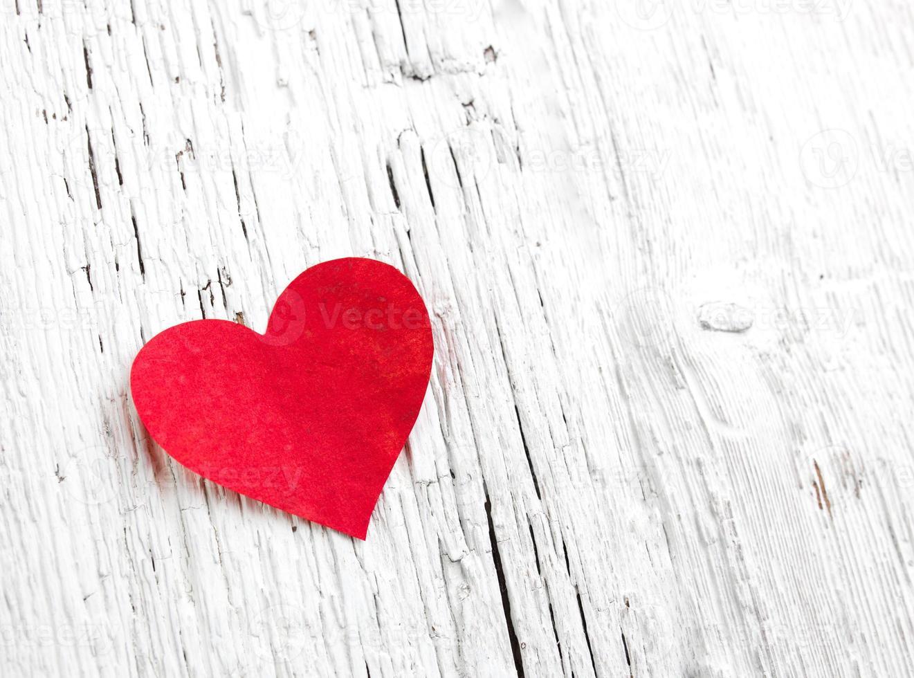 Heart on white wood background photo