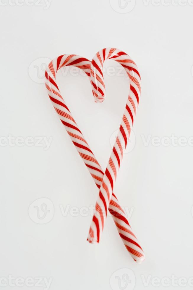 Candy canes in heart shape photo