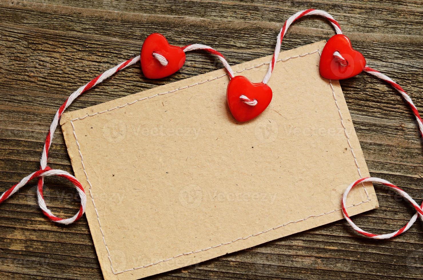 tres corazones y una tarjeta foto