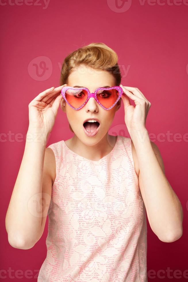 Retro girl with heart sunglasses photo