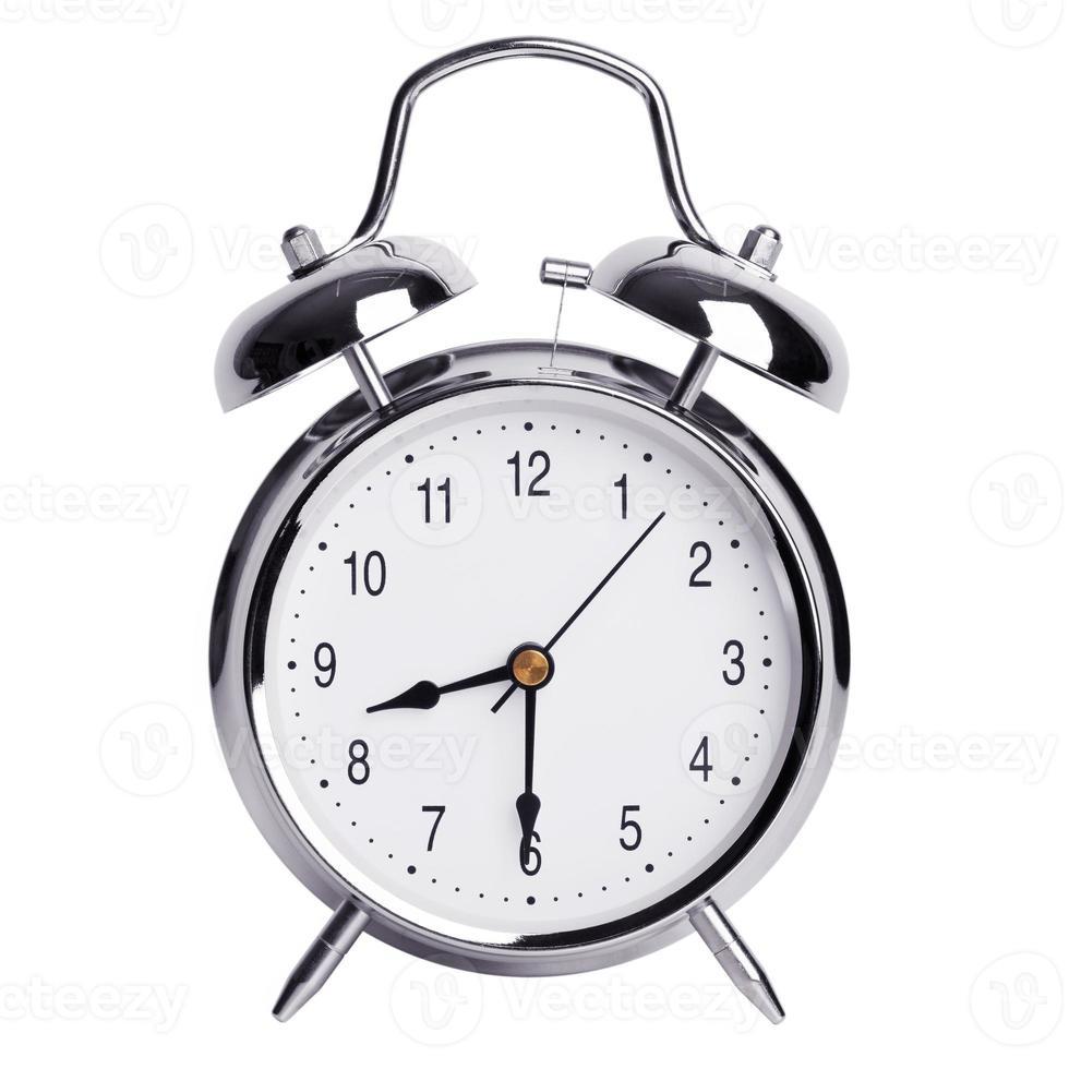 la mitad de la novena en un reloj despertador redondo foto