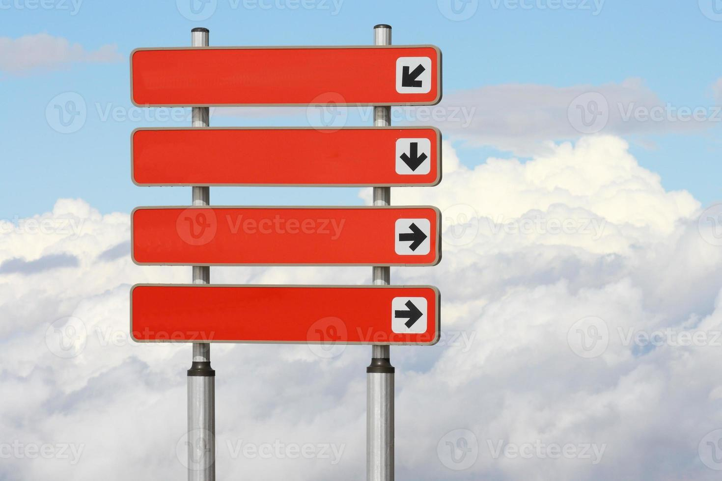 red signpost with direction arrows photo