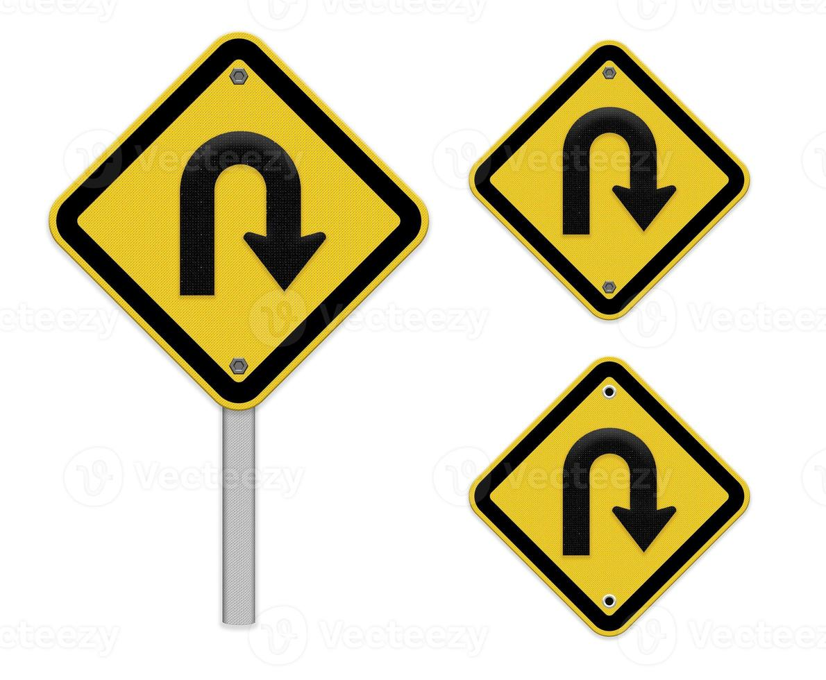 Roadsign de giro en U - señal de tráfico amarilla con símbolo de giro foto