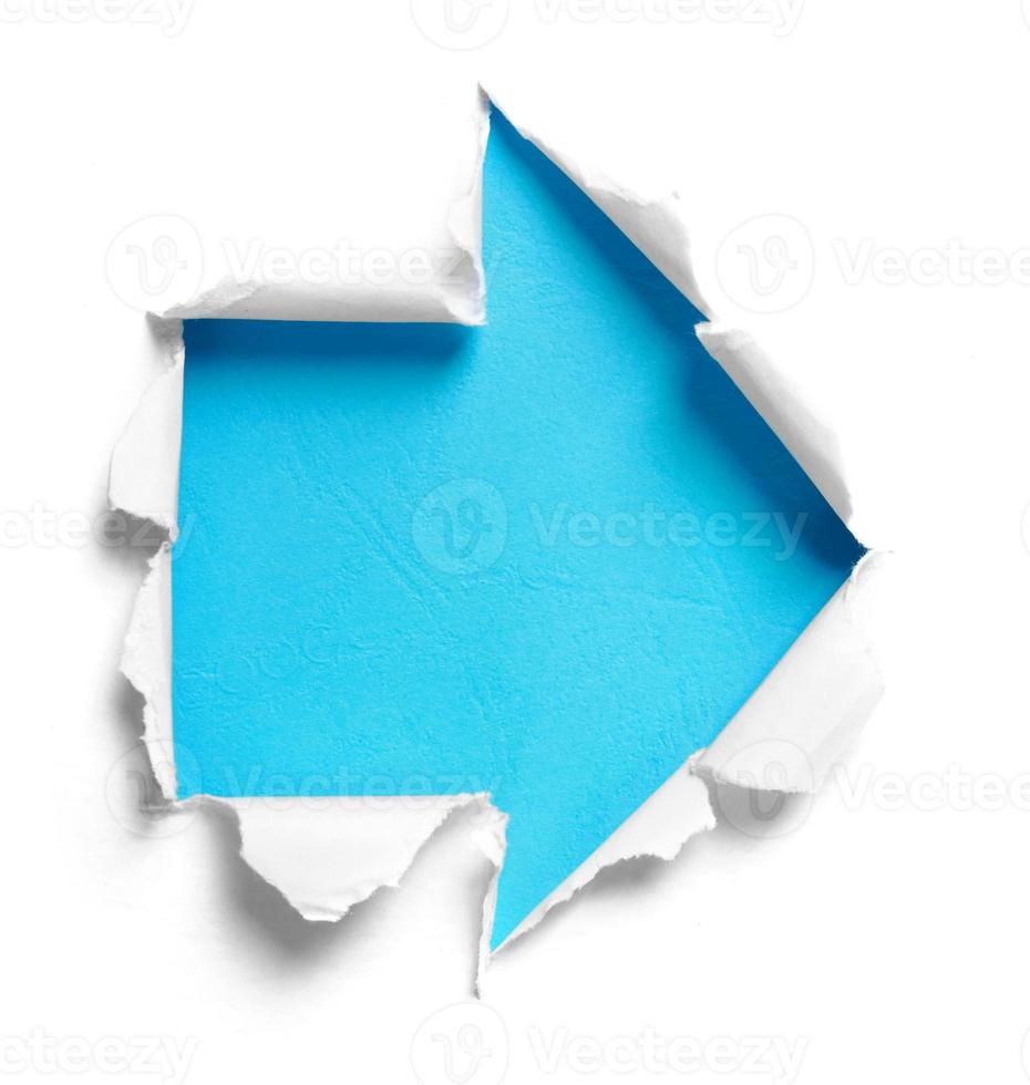 White torn paper with arrow shape photo