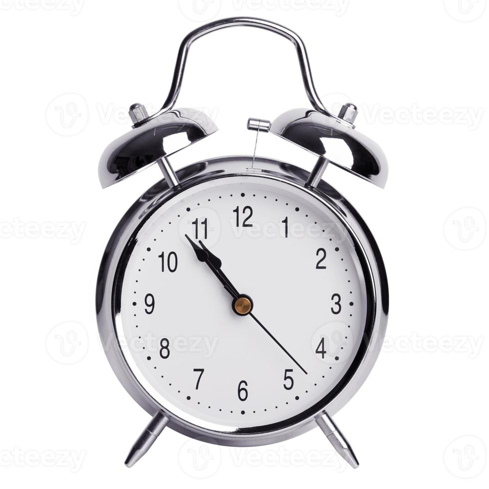 Five minutes to eleven on a alarm clock photo
