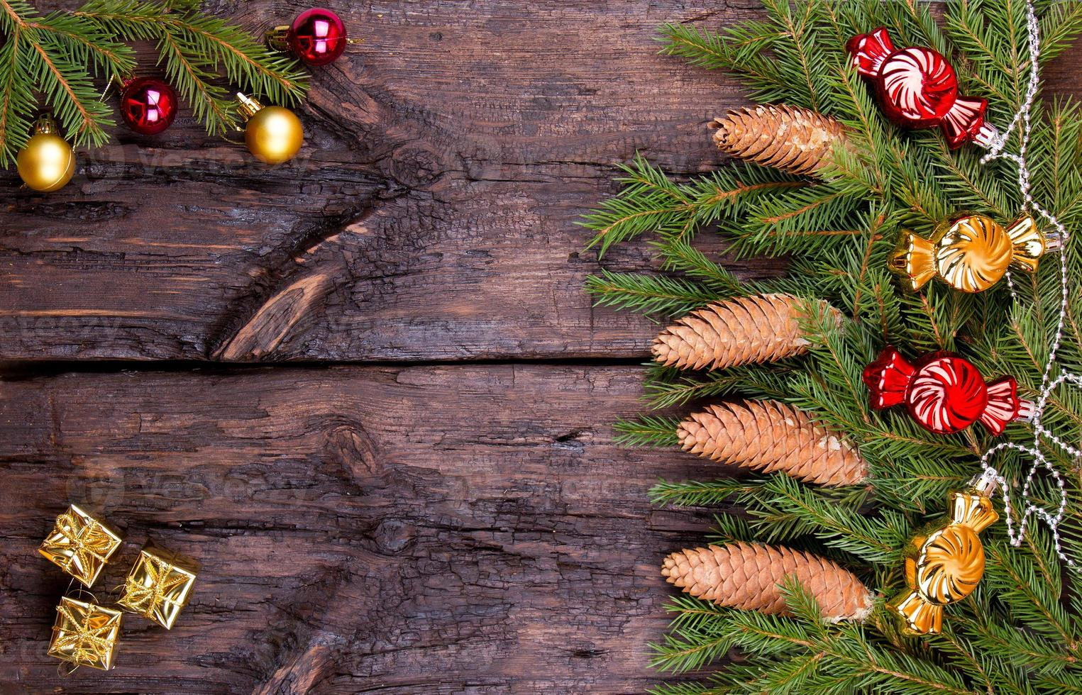 Fir cones, spheres and garlands on a wooden background photo