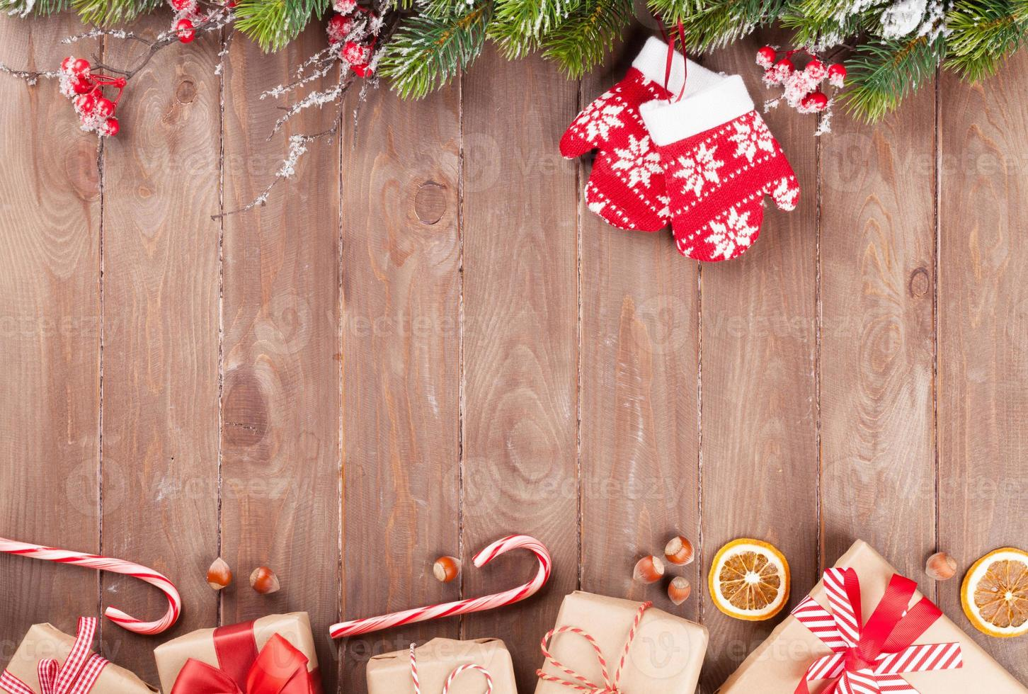 Christmas background with fir tree and gift boxes photo