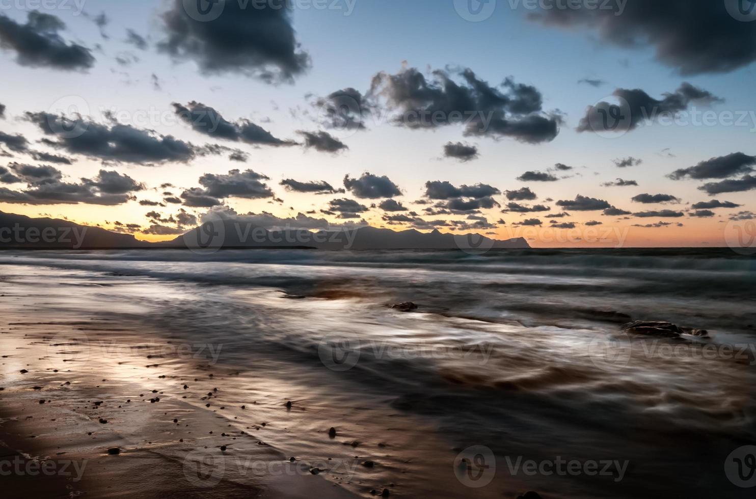 The Sicilian beach at sunset photo