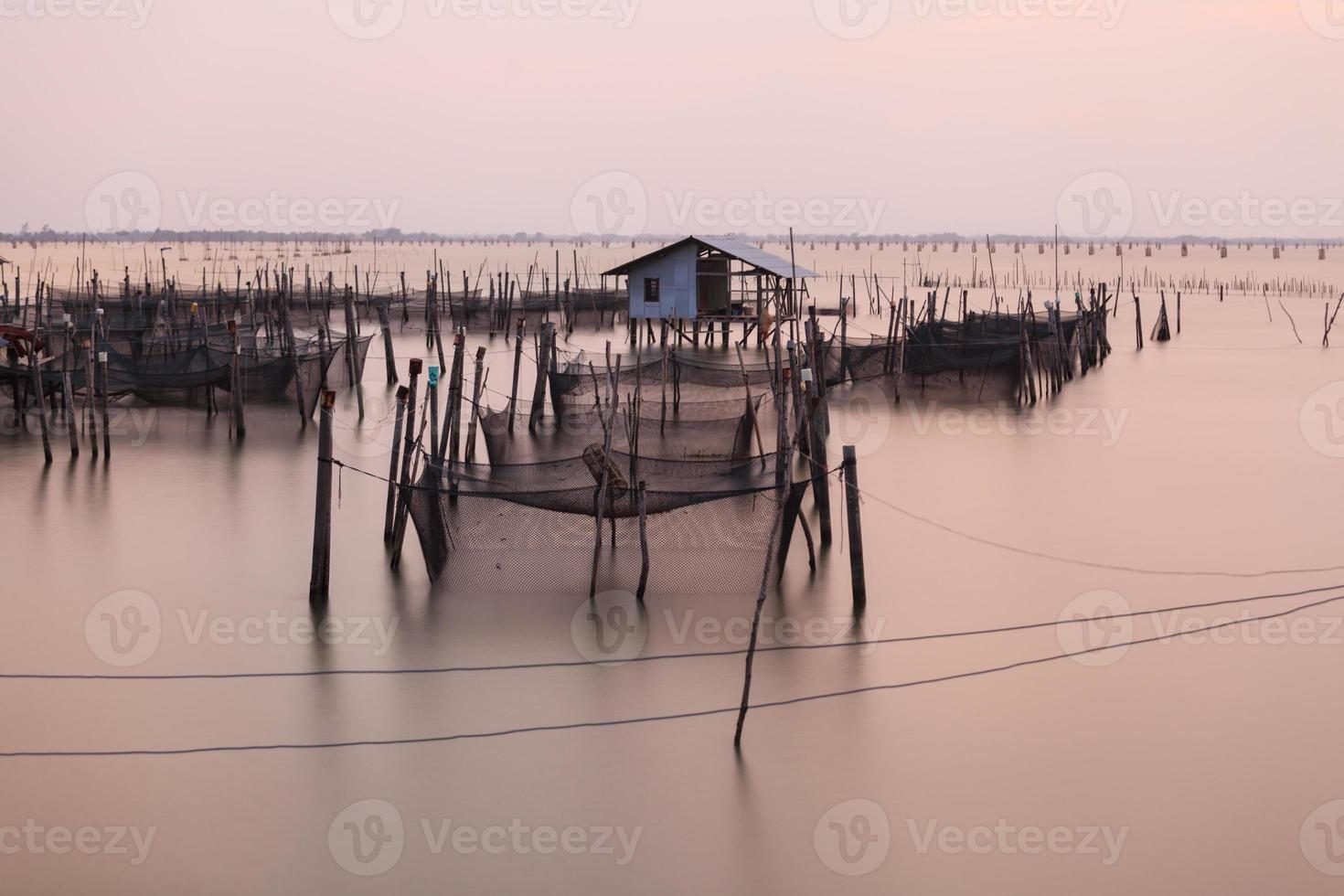Wooden pier on a blue lake sunset and cloudy sk photo