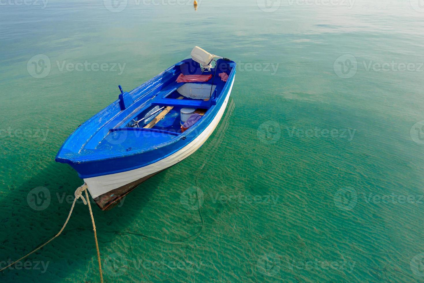 Azure blue motor boat floating on Greek Kos island photo