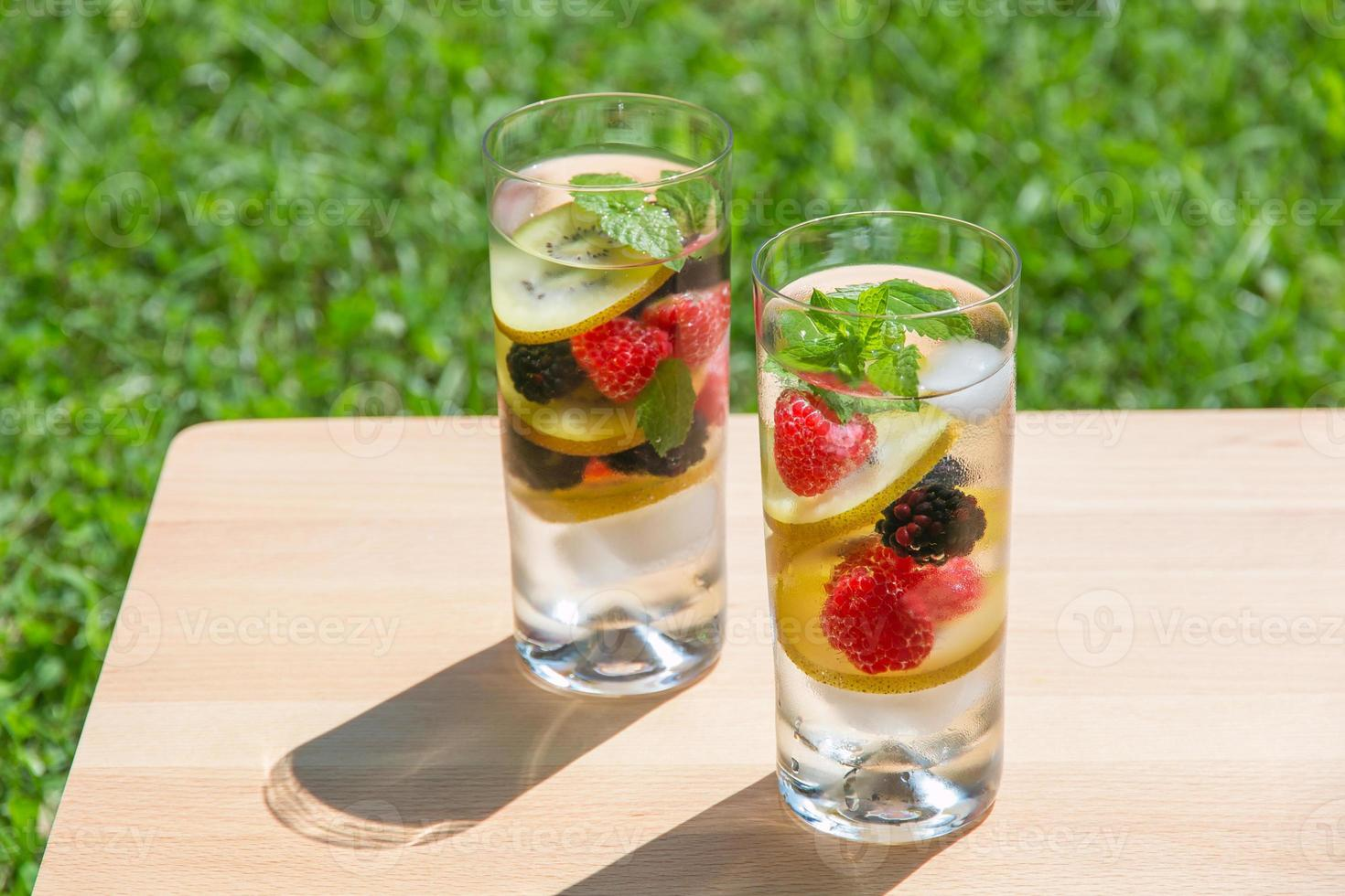 Infused water with  berries and golden kiwi. photo