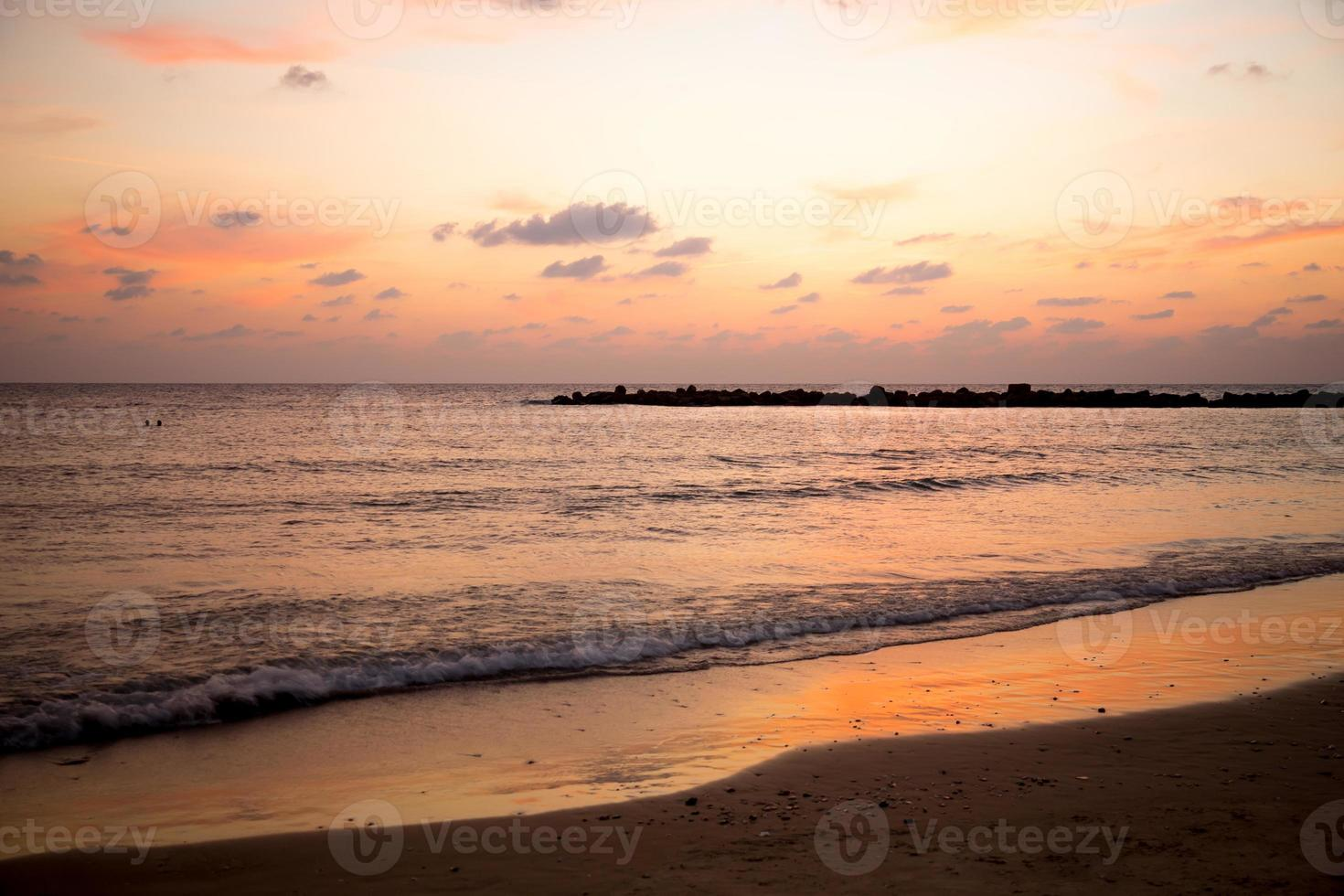 Sunset at a beach photo