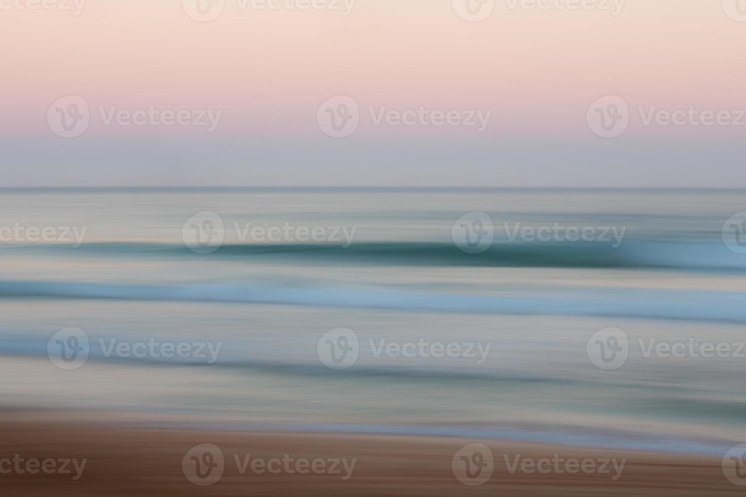 Fondo abstracto del océano amanecer con movimiento panorámico borroso foto