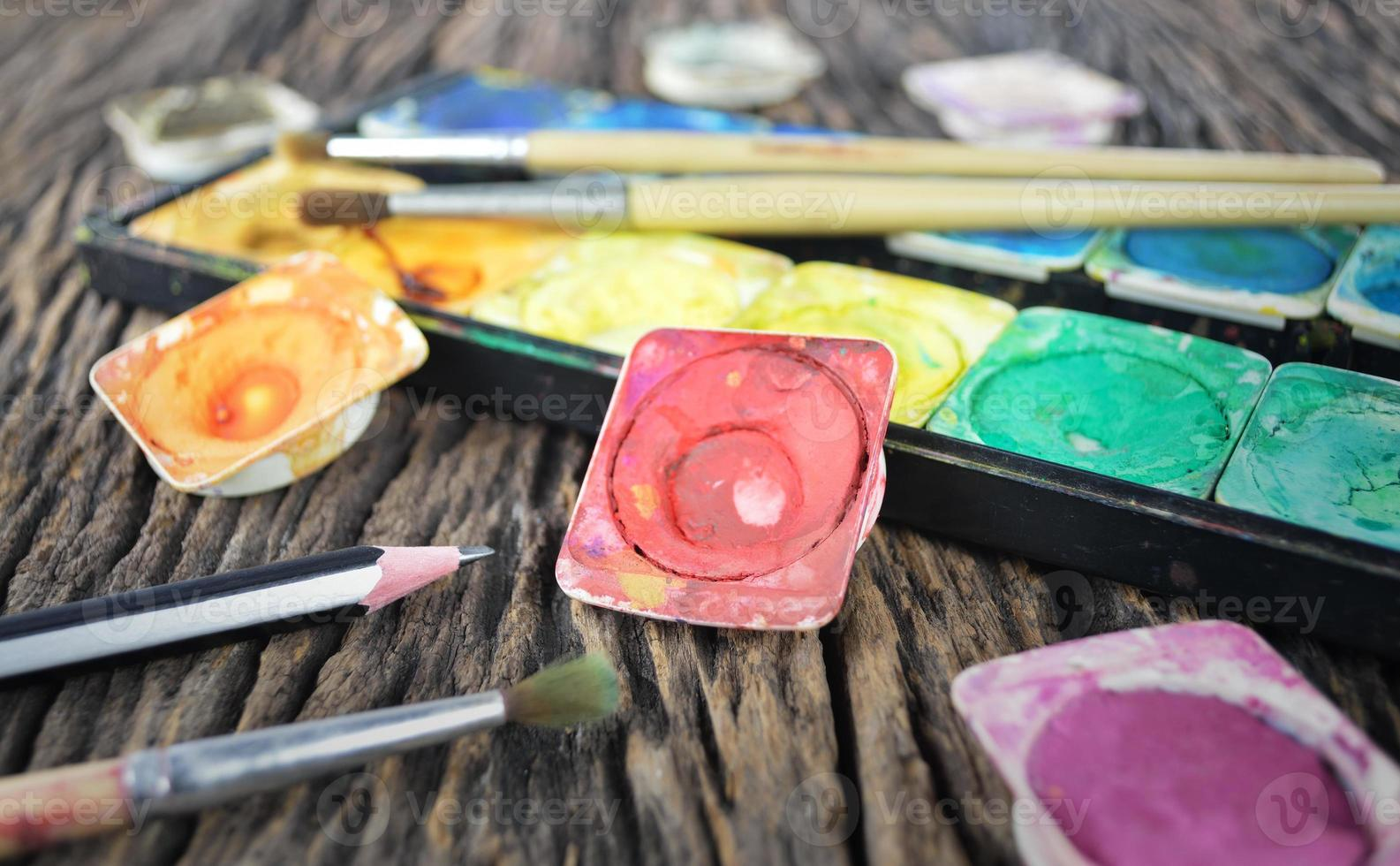 Water color paint box and paint brush photo