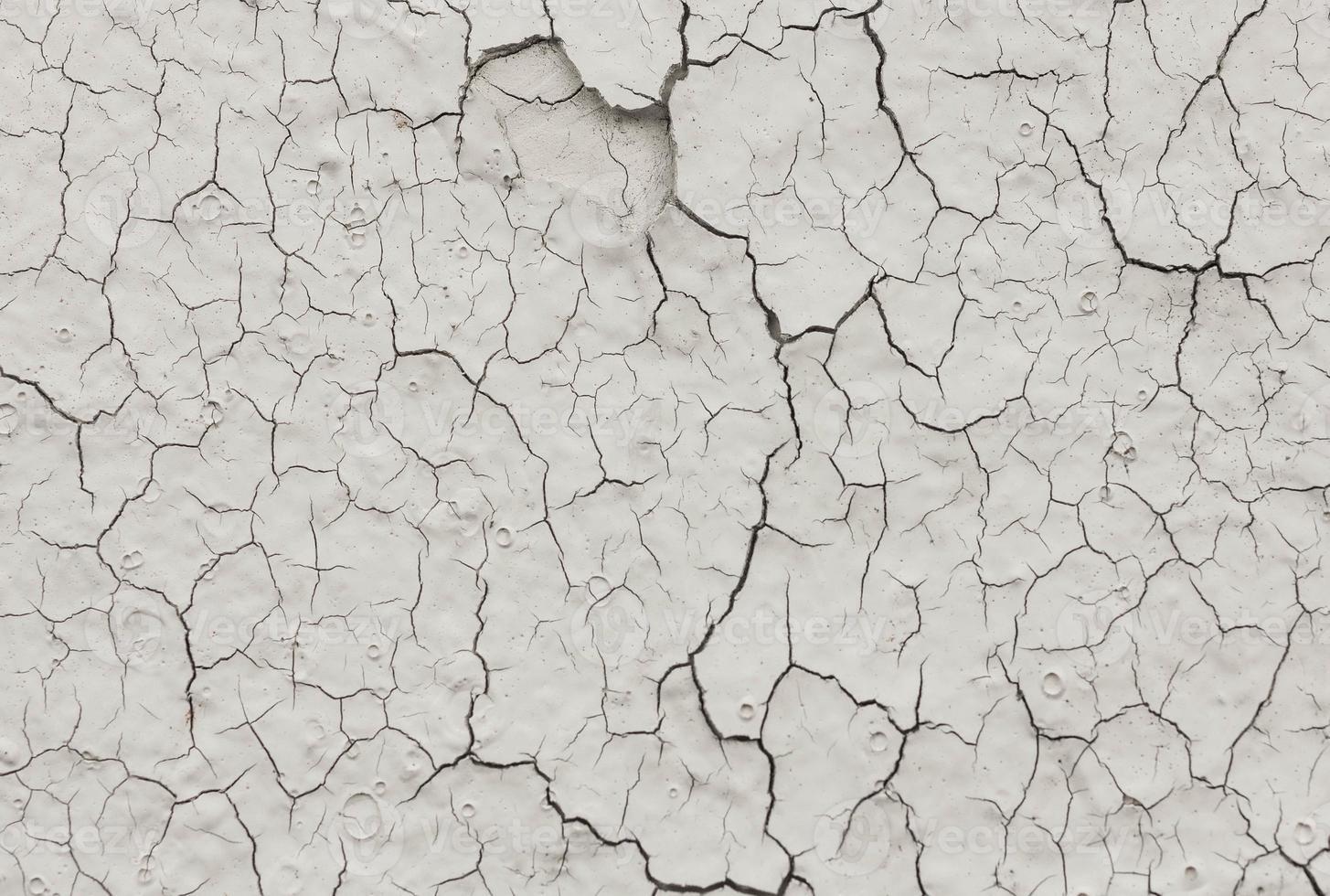 textura de pared agrietada pintada foto