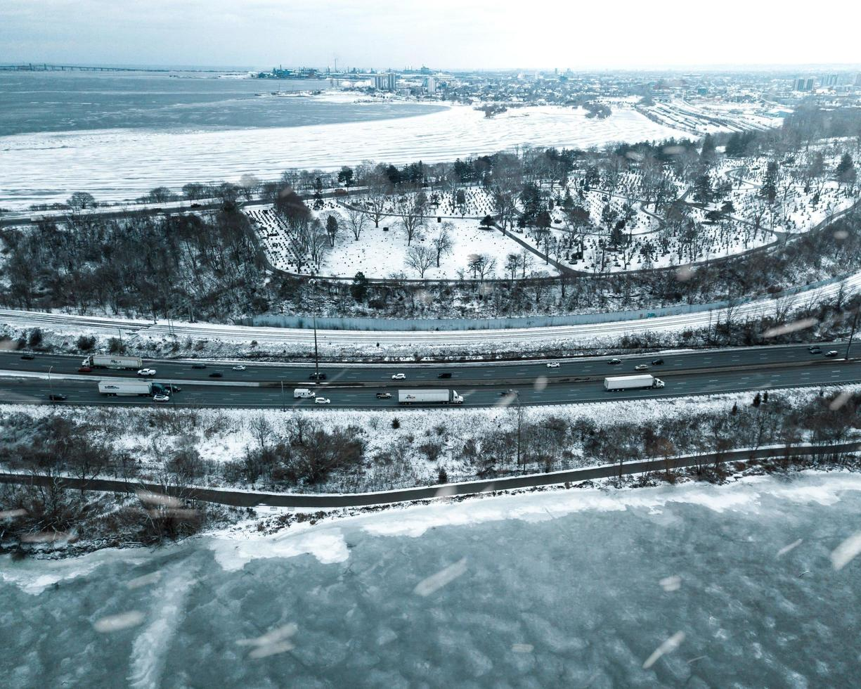 Aerial view of vehicles passing on winter roads during daytime photo