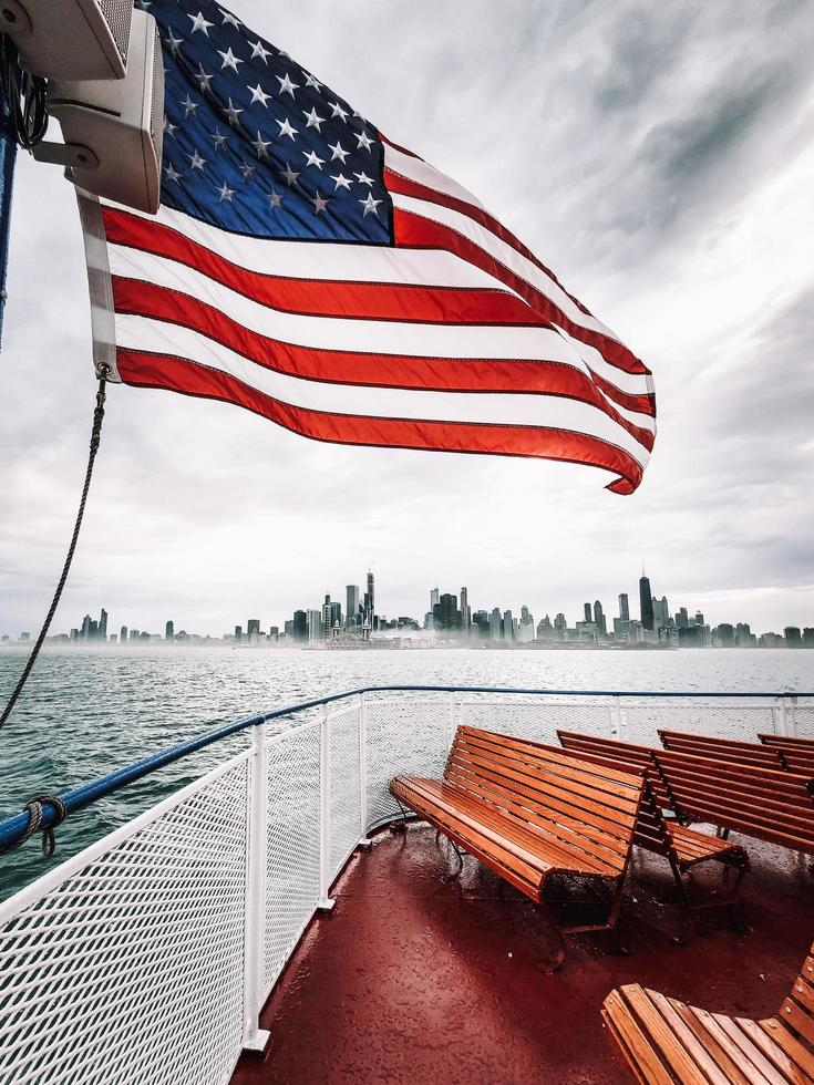 waving US flag on a boat photo