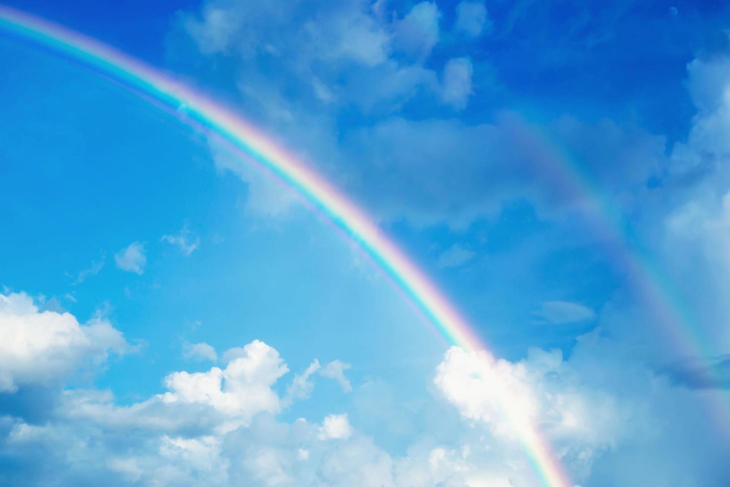 Beautiful rainbows born naturally after rain photo