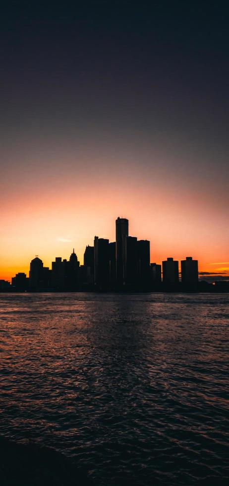 Silhouette of city skyline during golden hour photo