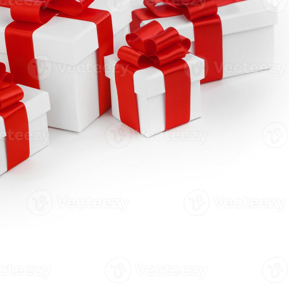 White gift boxes with red ribbons photo