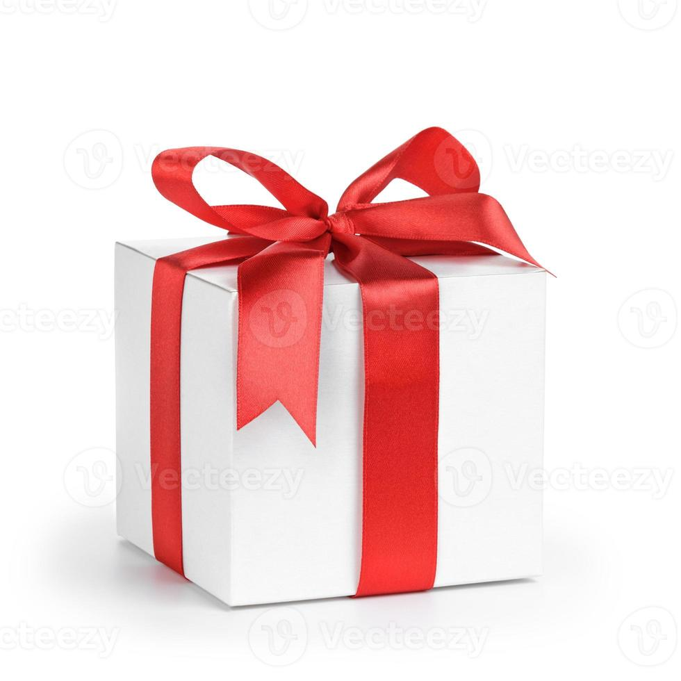 white present paper box with red ribbon bow photo