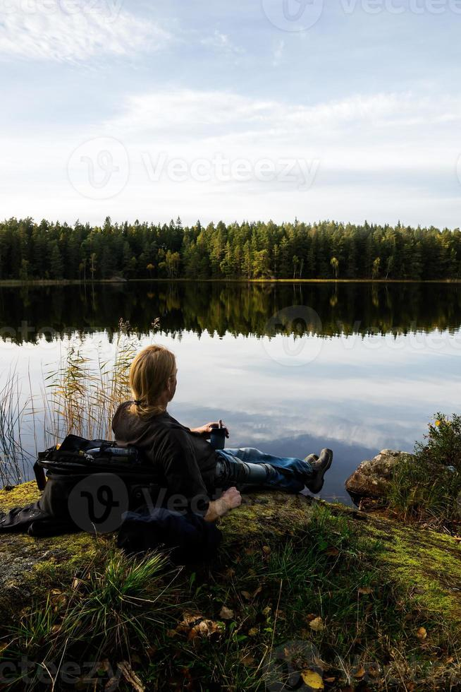 Hiker with coffe photo