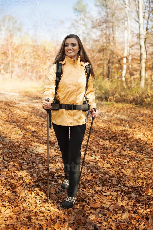 Attractive young woman hiking photo