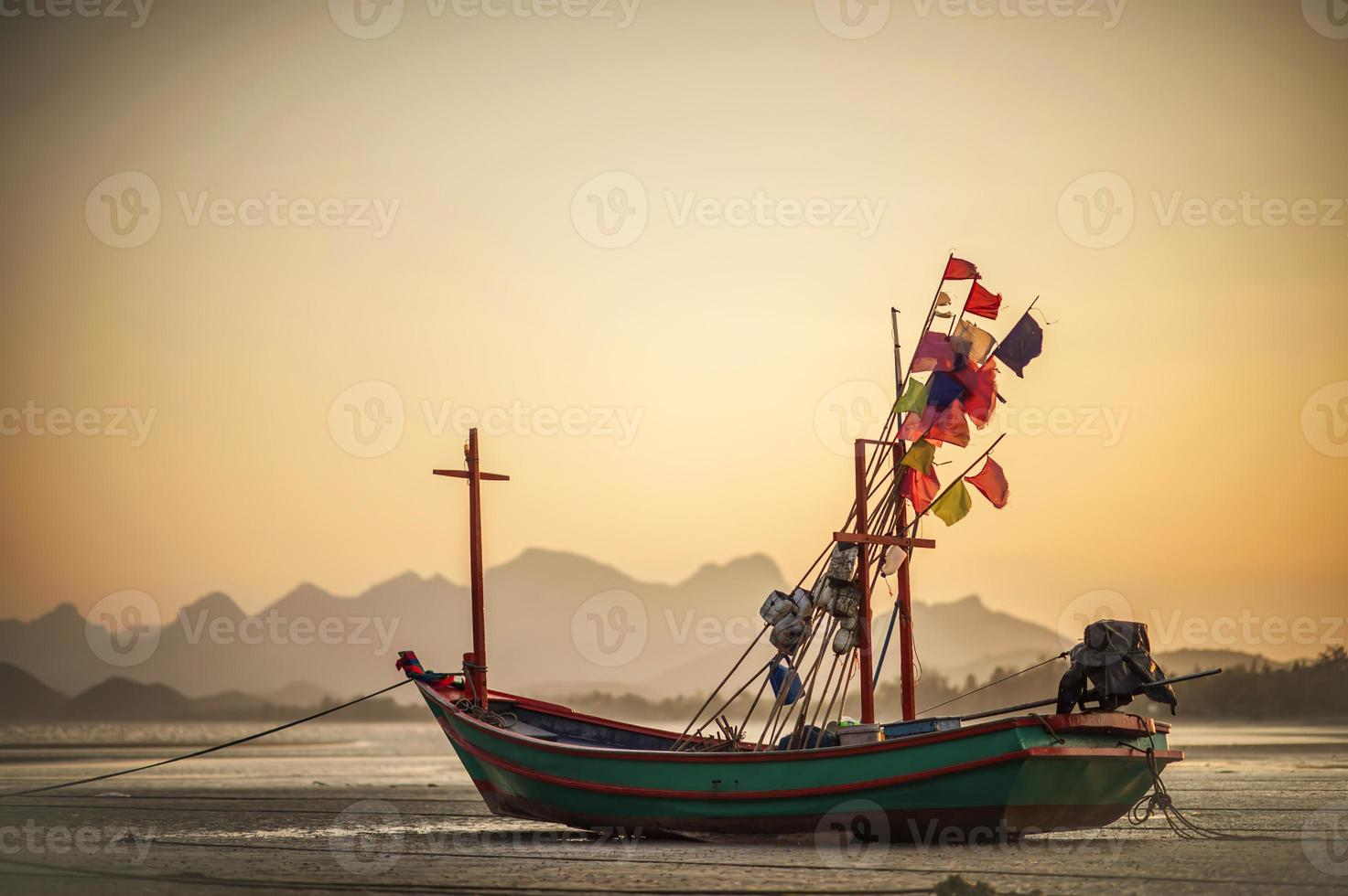 Long tail boat on the beach. photo