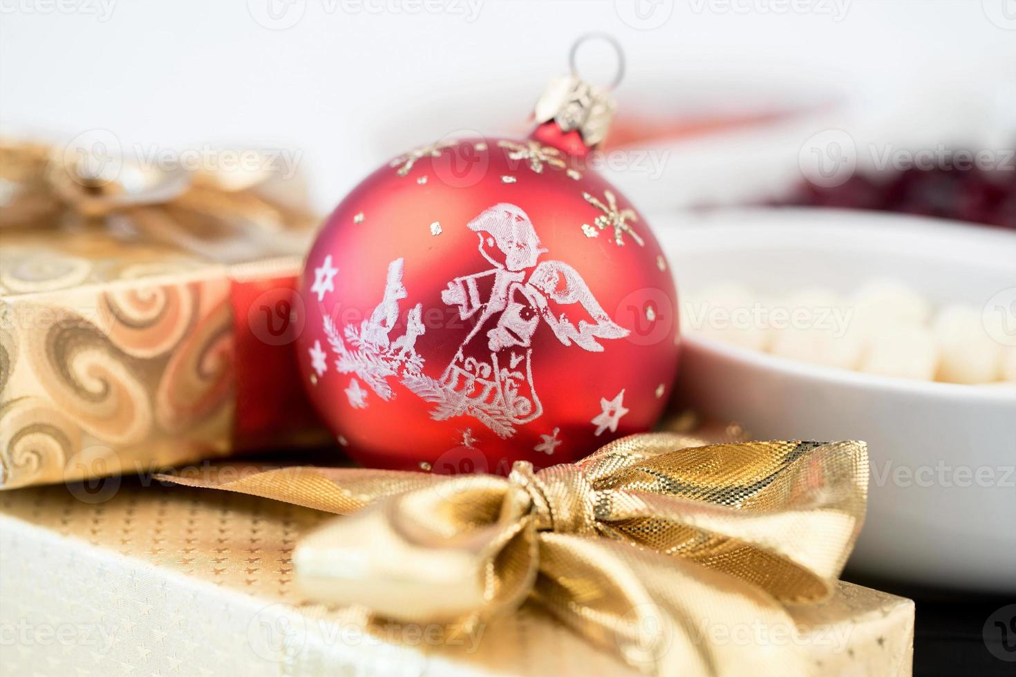 christmas decoration and golden box with ribbon photo