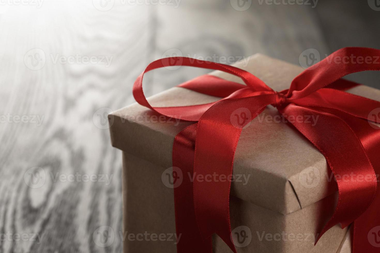 rustic gift box with red ribbon bow photo