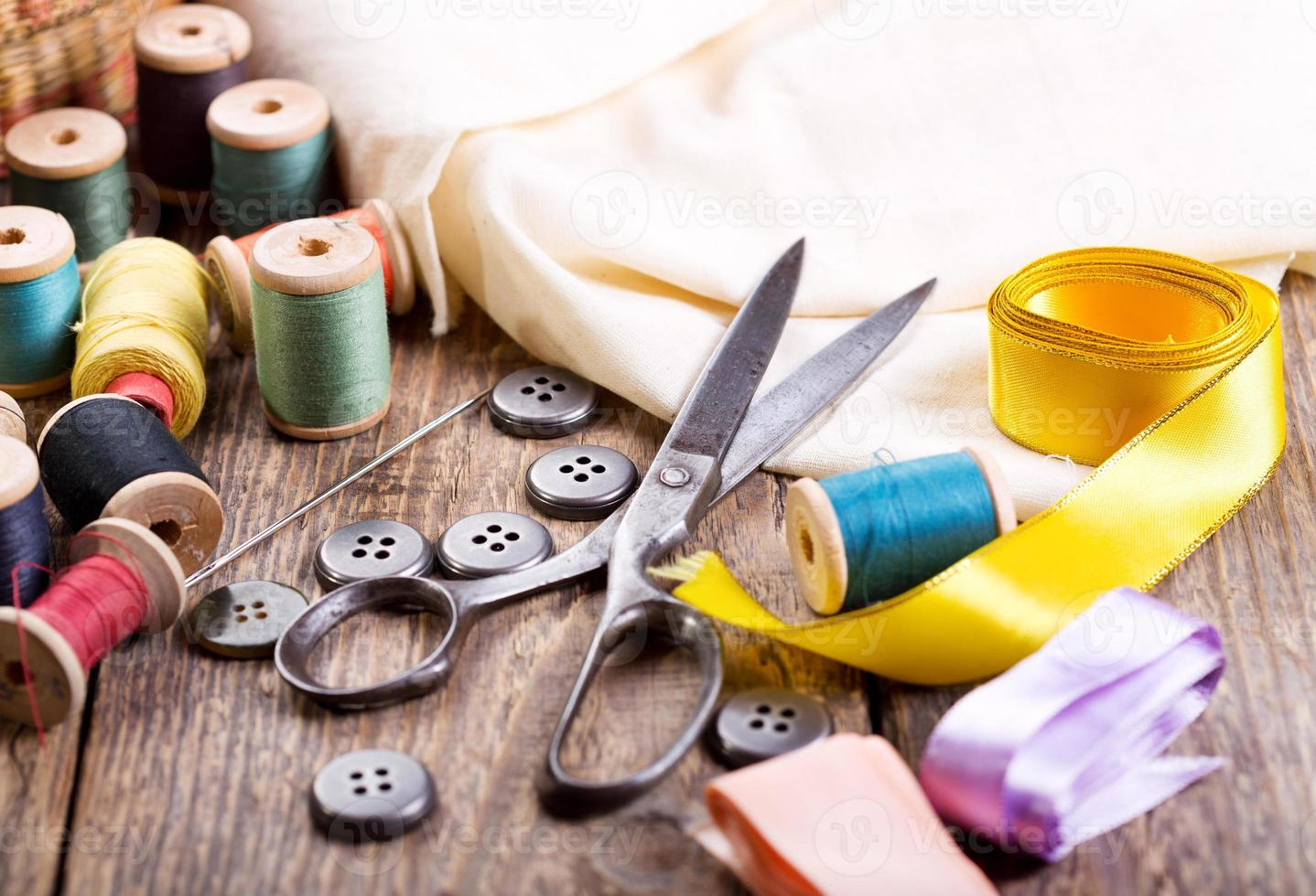 Old scissors, buttons, threads photo