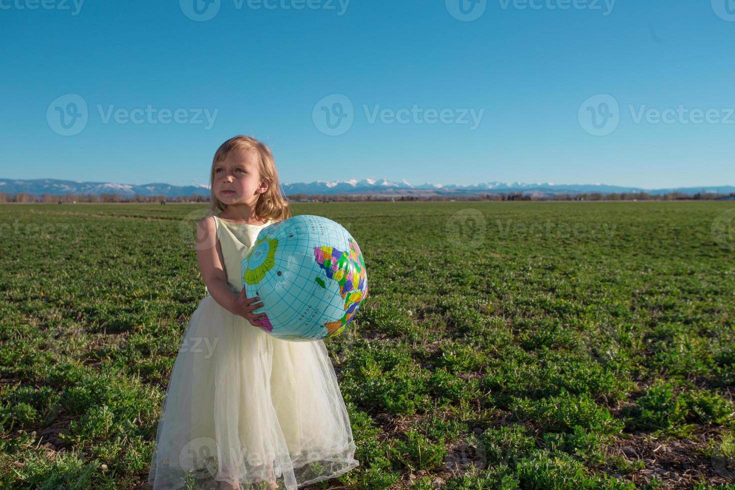 Girl with world globe photo