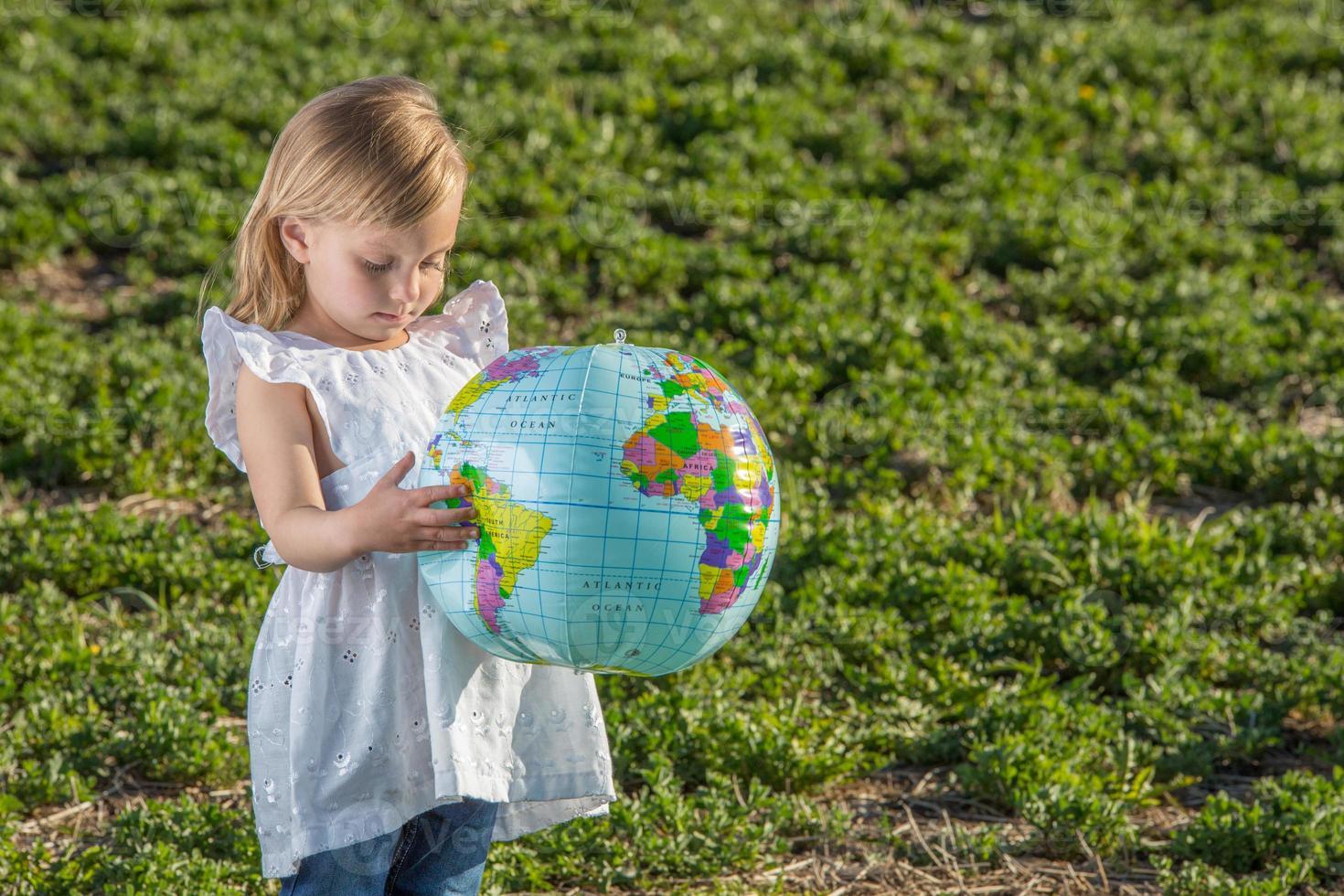 Girl with world globe. photo