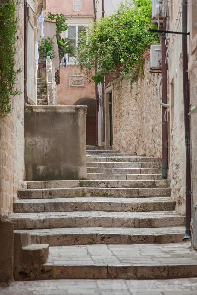 Empty stone street stairway in old town in Dubrovnik, Croatia. photo