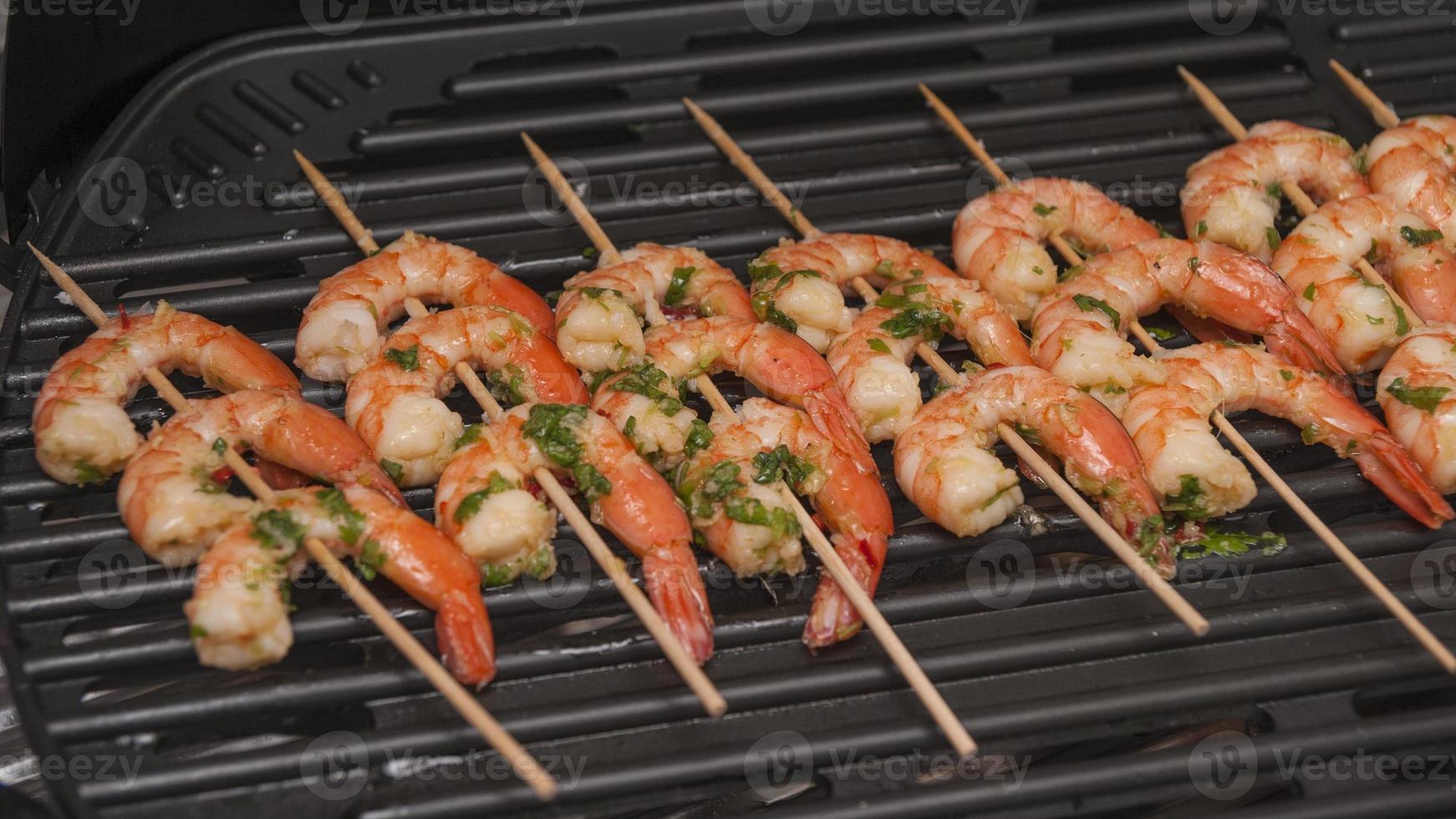 shish kebab from sea shrimps photo