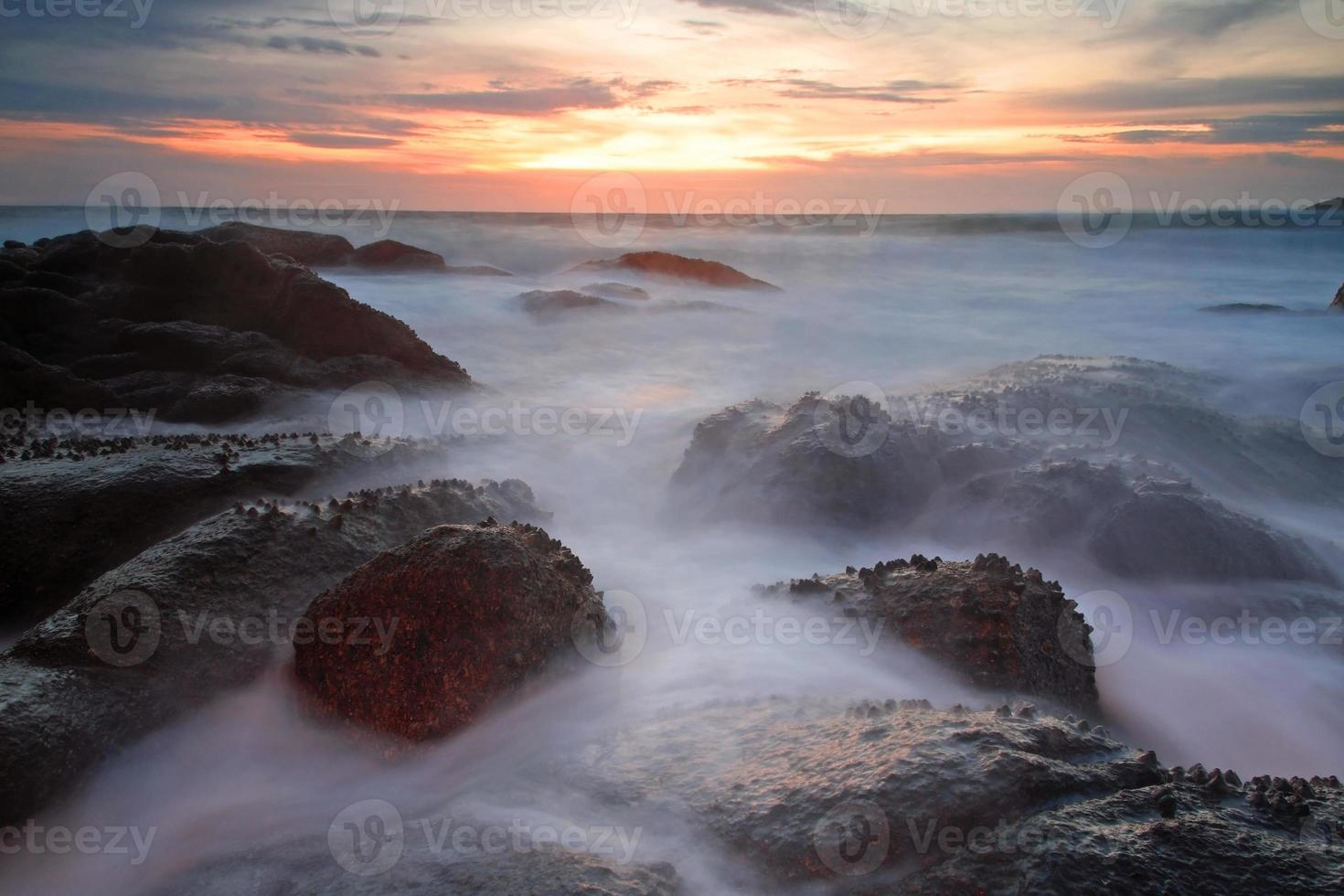 Motion Sea waves hit rock on beach, Phuket photo