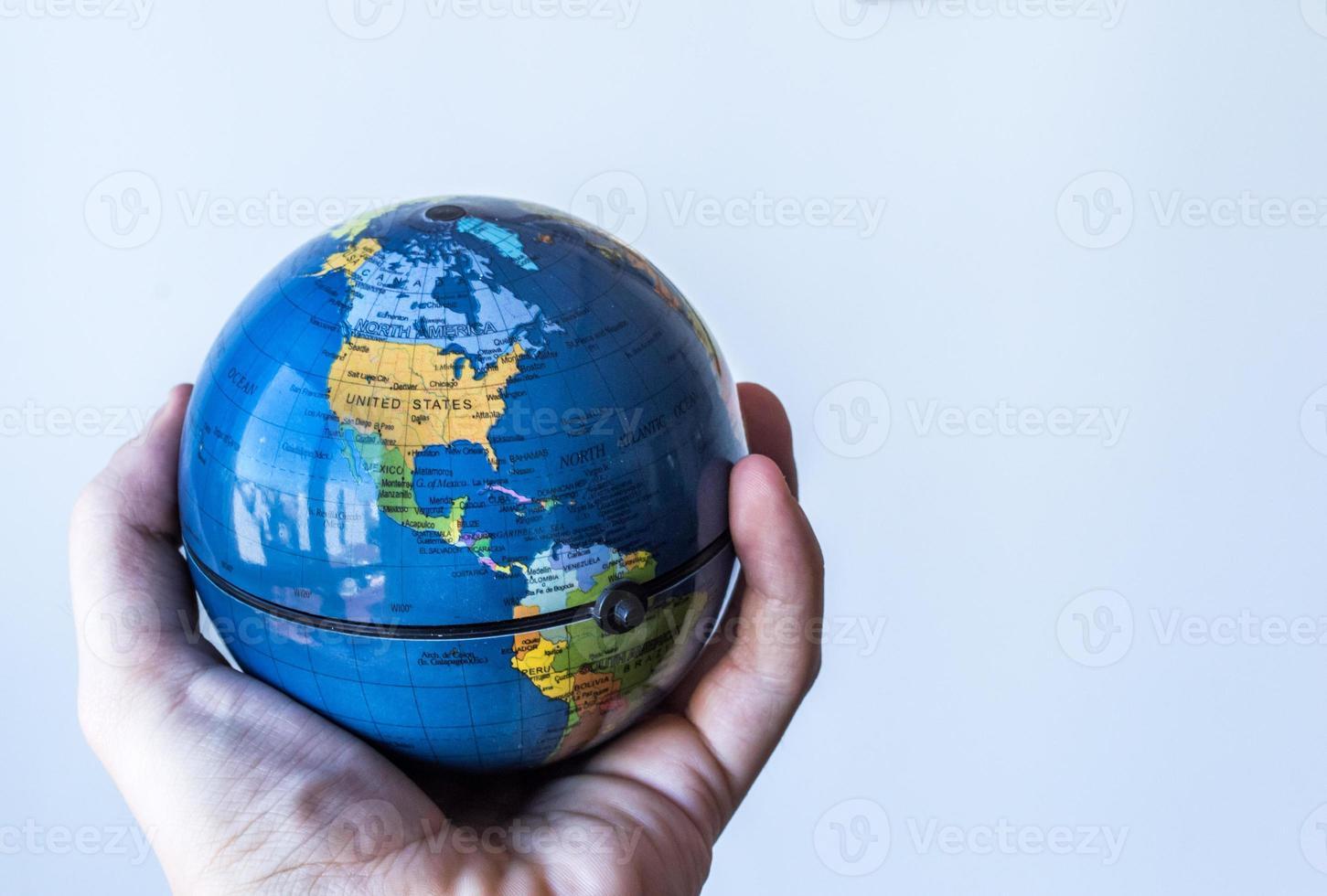 Globe in Palm of Hand USA/North America photo