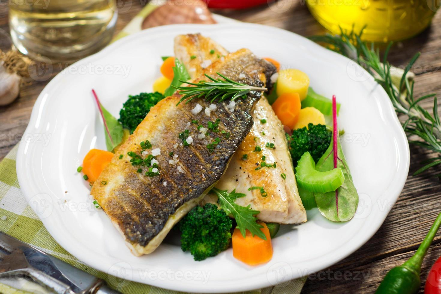 Sea bass fillet with vegetables photo