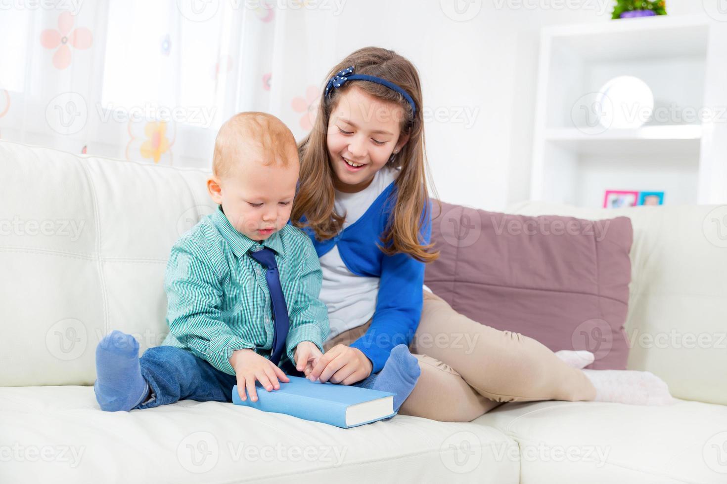 Children reading book photo