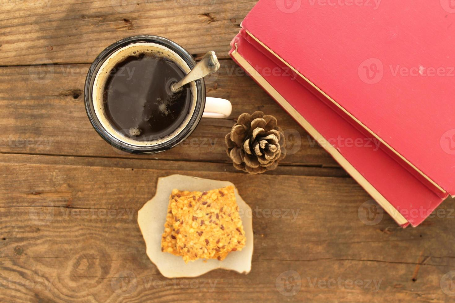 Winter concept - hot chocolate mug, vintage book and cookie photo