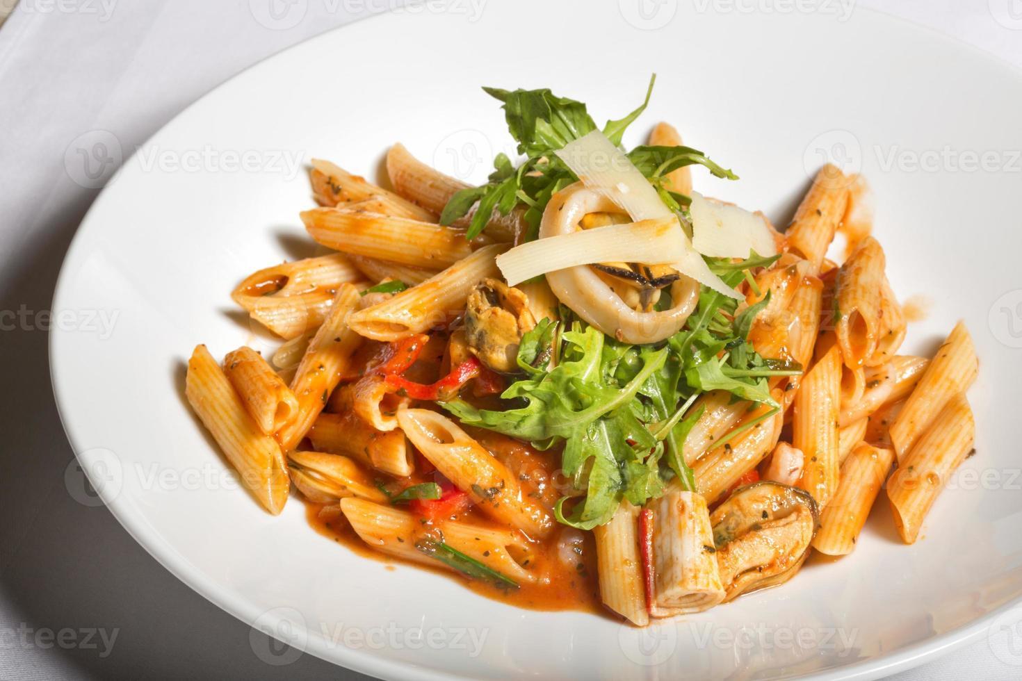 Sea food and tomato sauce pasta photo