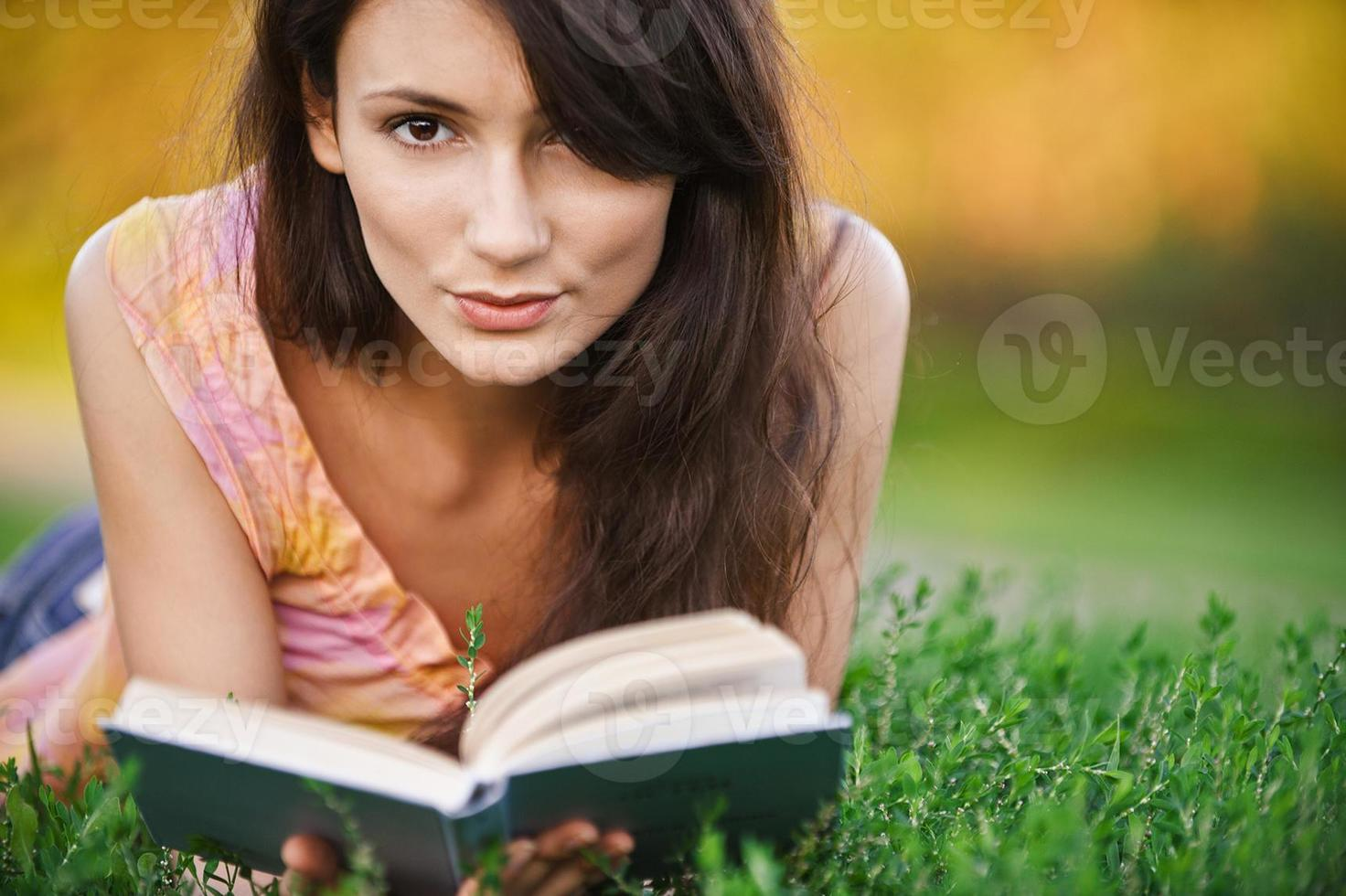 Girl reads book photo
