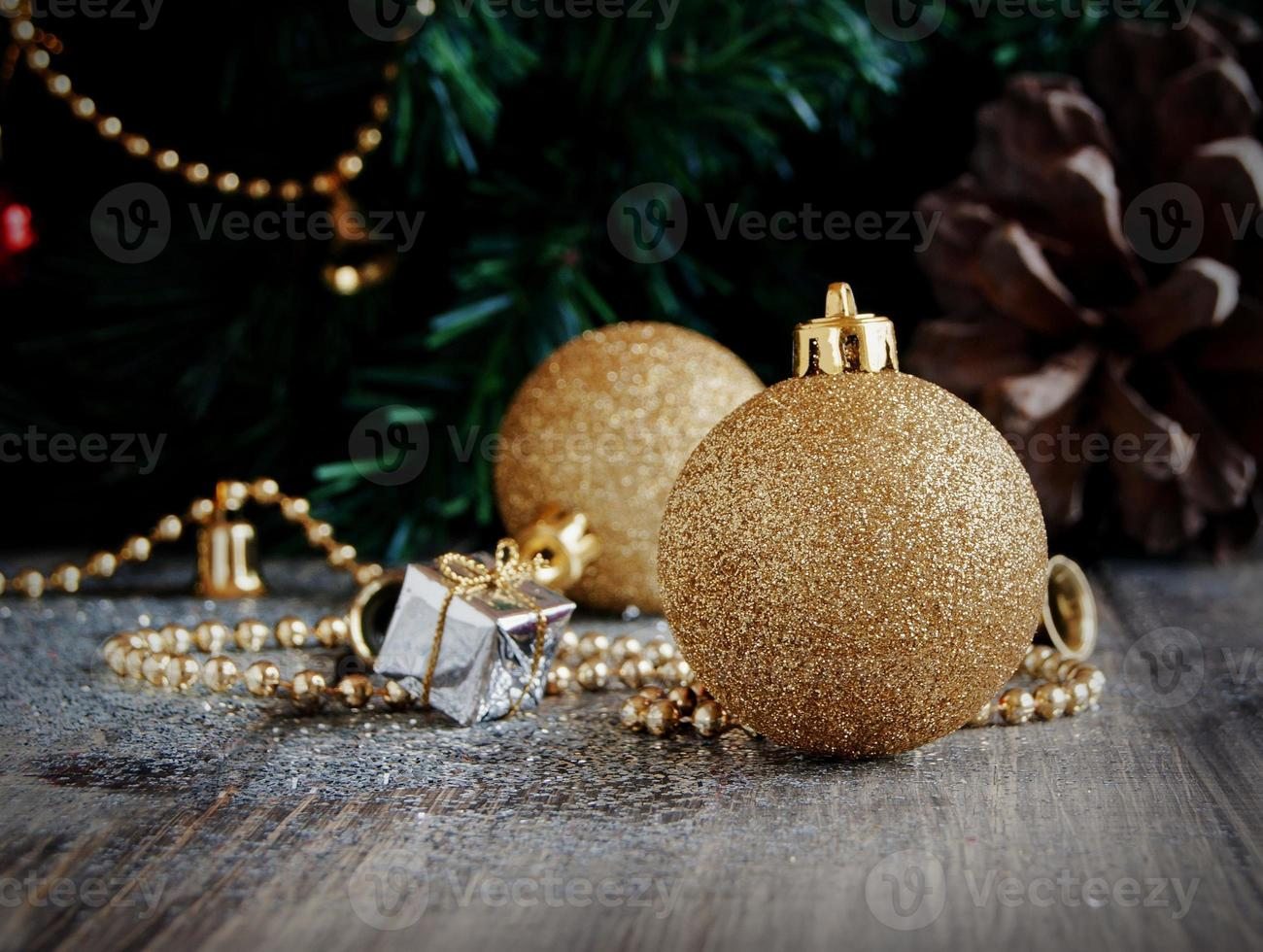 Christmas decorations on a background of trees and cones photo