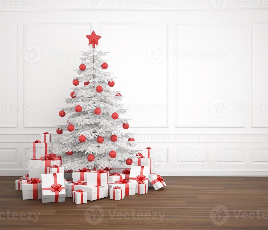 árbol de navidad blanco y rojo en una habitación vacía foto