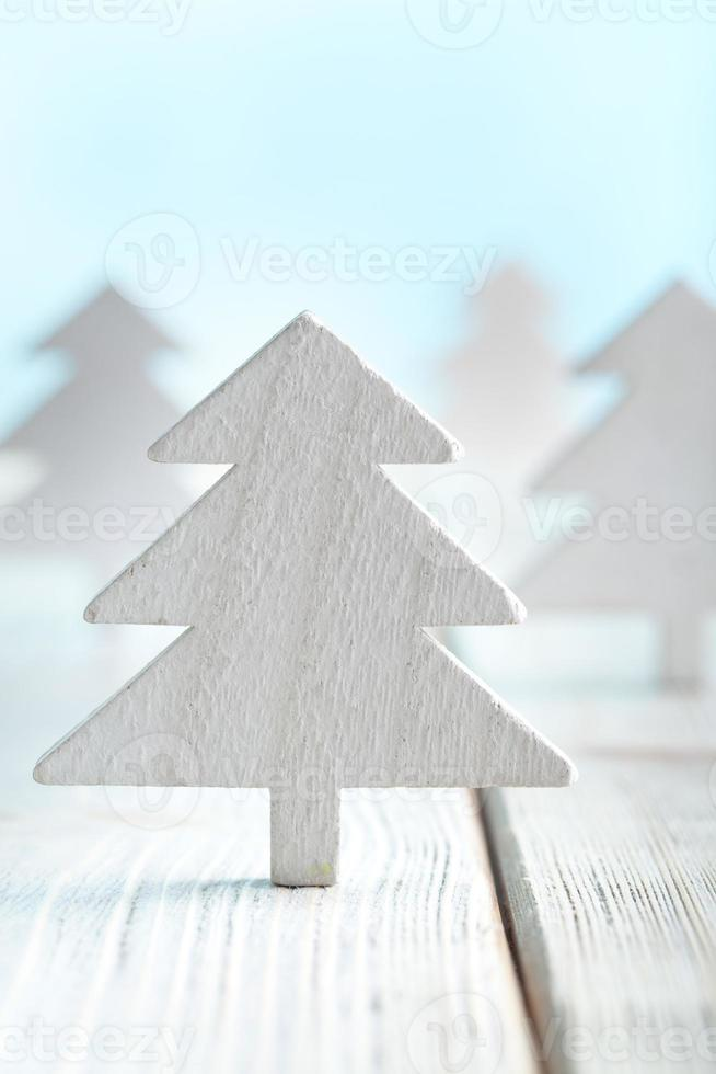 Christmas trees on wooden and blue background photo
