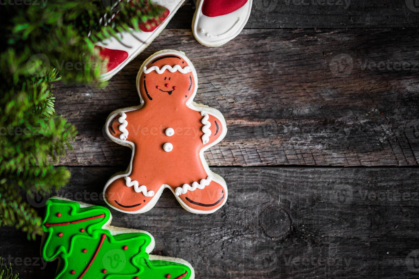 Christmas cookies on rustic wooden background photo